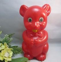 1960's Red plastic teddy bear piggy, coin bank. Googly eyes - $17.09
