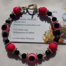 evil eye pink and black handmade bracelet silve... - $8.00