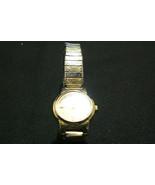 Vintage Seiko Quartz Gold Tone Women's flexible Wrist Band Watch - $9.89