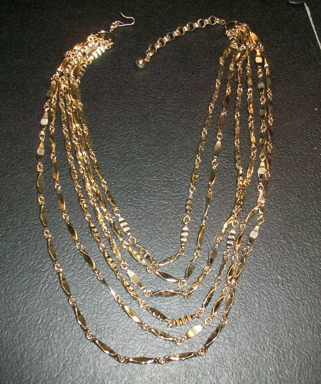 Brilliant Gold Tone Multi-Strand Necklace with 6 Strands and J Hook Clasp