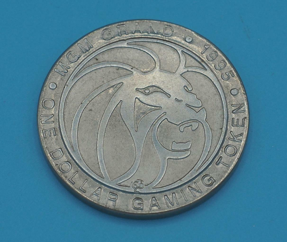 Primary image for Vintage Casino $1 Gaming Token MGM Grand 1995