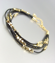CHIC & SHIMMERY Black Leather Multi Cords Faceted Gold Beads Bracelet - $15.99