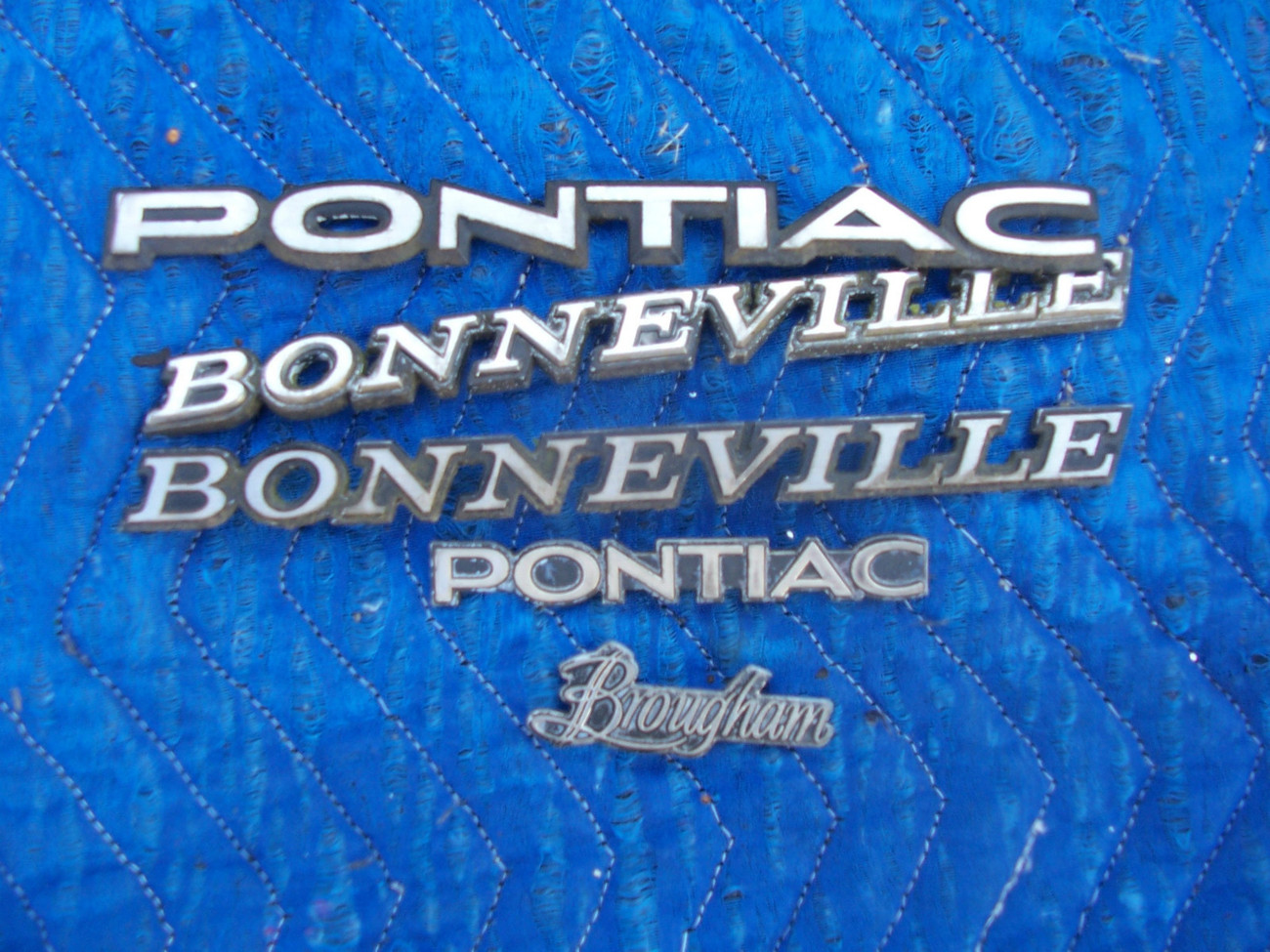 Primary image for 1983 BONNEVILLE MISC SIDE REAR TRIM EMBLEM OEM USED WEAR ORIG PONTIAC GM PART