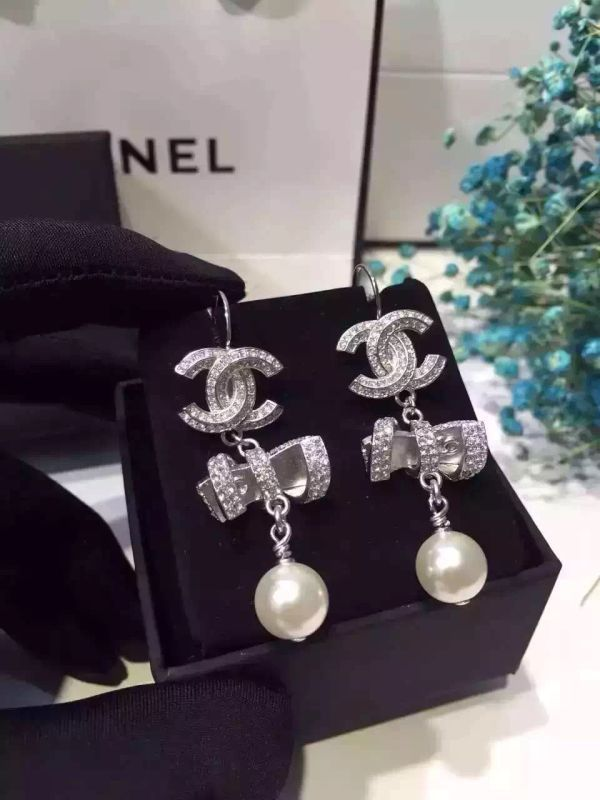 Authentic Chanel 2016 Ribbon Bow CC Crystal Dangle Pearl Drop Earrings