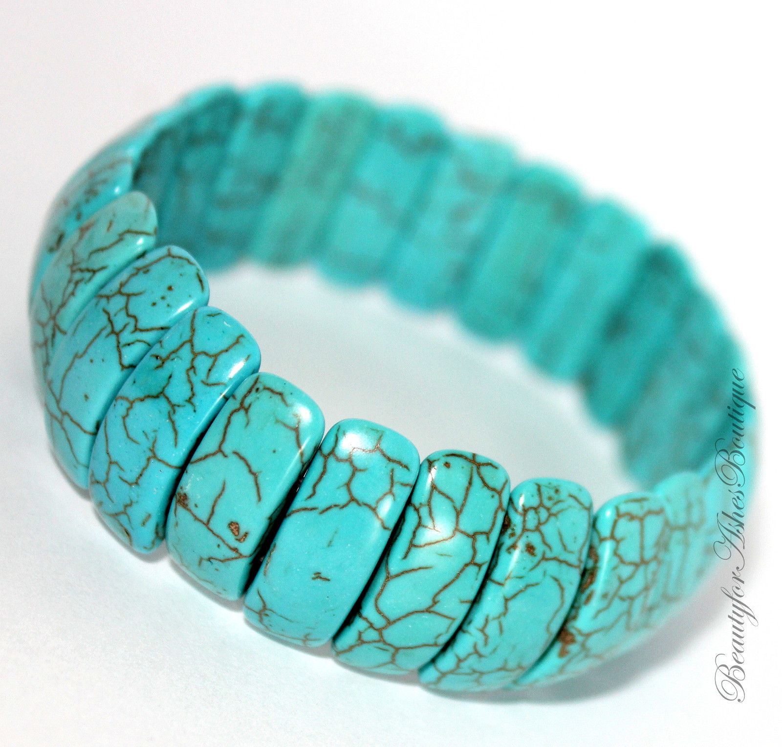 "Primary image for Ladies 3/4"" Wide Faux Natural Rustic Cabo Blue Turquoise Stone Stretch Bracelet"