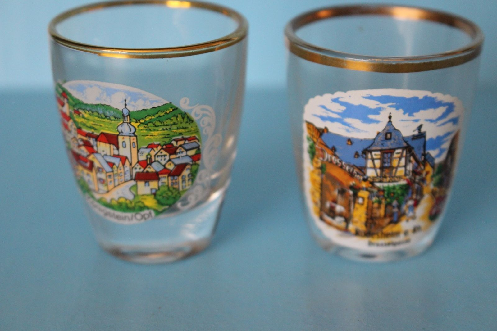 VINTAGE - GERMAN SHOT GLASSES GERMAN TOWNS, MOUNTAINS WITH GOLD TRIM