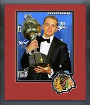 Patrick Kane with the 2016 Hart Trophy-11 x14 Team Logo Matted/Framed Photo - $42.95