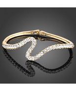 HOLIDAY CLEARANCE SALE! Swarovski Crystal Swirl Design Bangle In Gold Pl... - $18.00