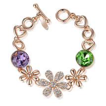 Charming 18K Yellow gold GP bracelet with Swarovski crystals flower and ... - $24.00