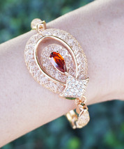Red Teardrop Eye Netted Crystals Rose Gold Tone Bracelet - $26.00