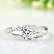 18k White Gold Plated Engagement / Promise Ring With Round Cut Zircon Crystals - $19.00