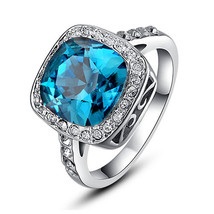 18k White Gold Plated Ocean Blue Countess Ring With Halo Setting And Pave Crysta - $22.00
