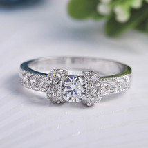 Silver Toned Ring With Round Cut Stones On Pave Setting Engagement/Promise Ring - $22.00