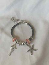 Artisan charm bracelet with silver seahorse and starfish charms - $11.87