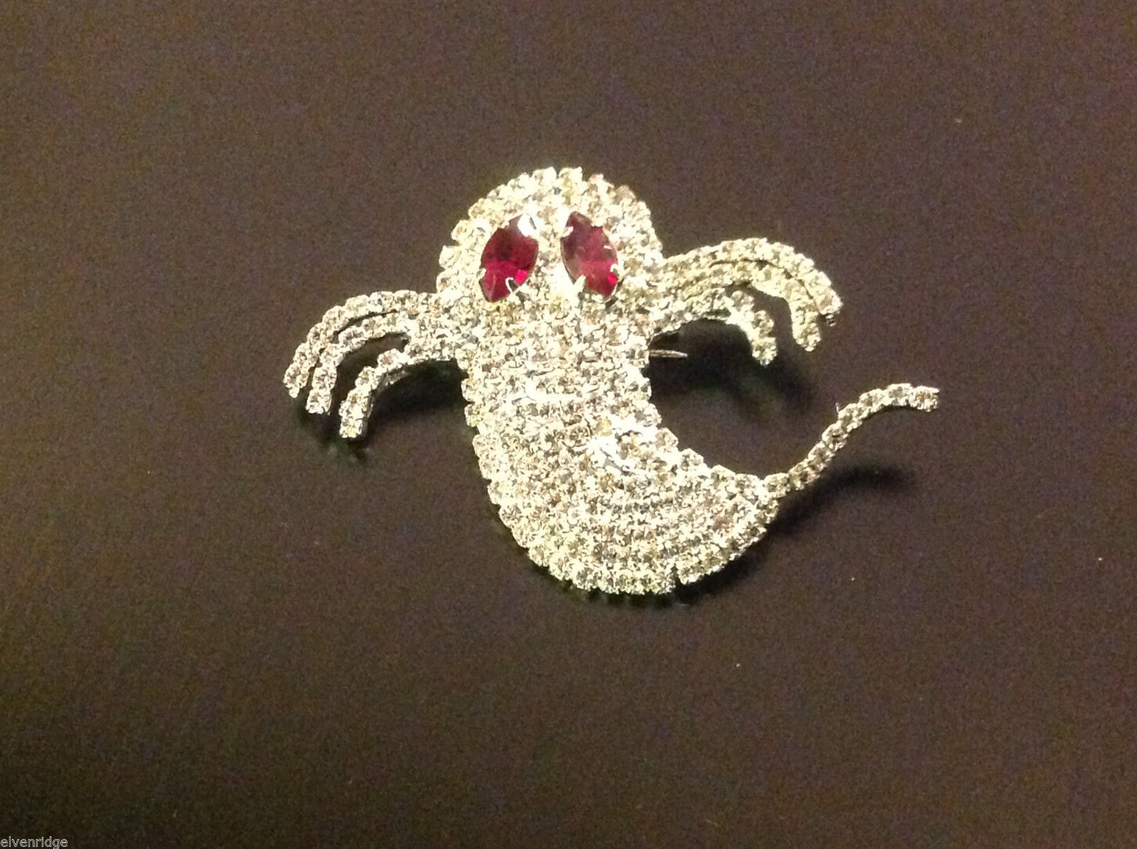 Beautiful sparkly new rhinestone pin with ghost and red eye crystals
