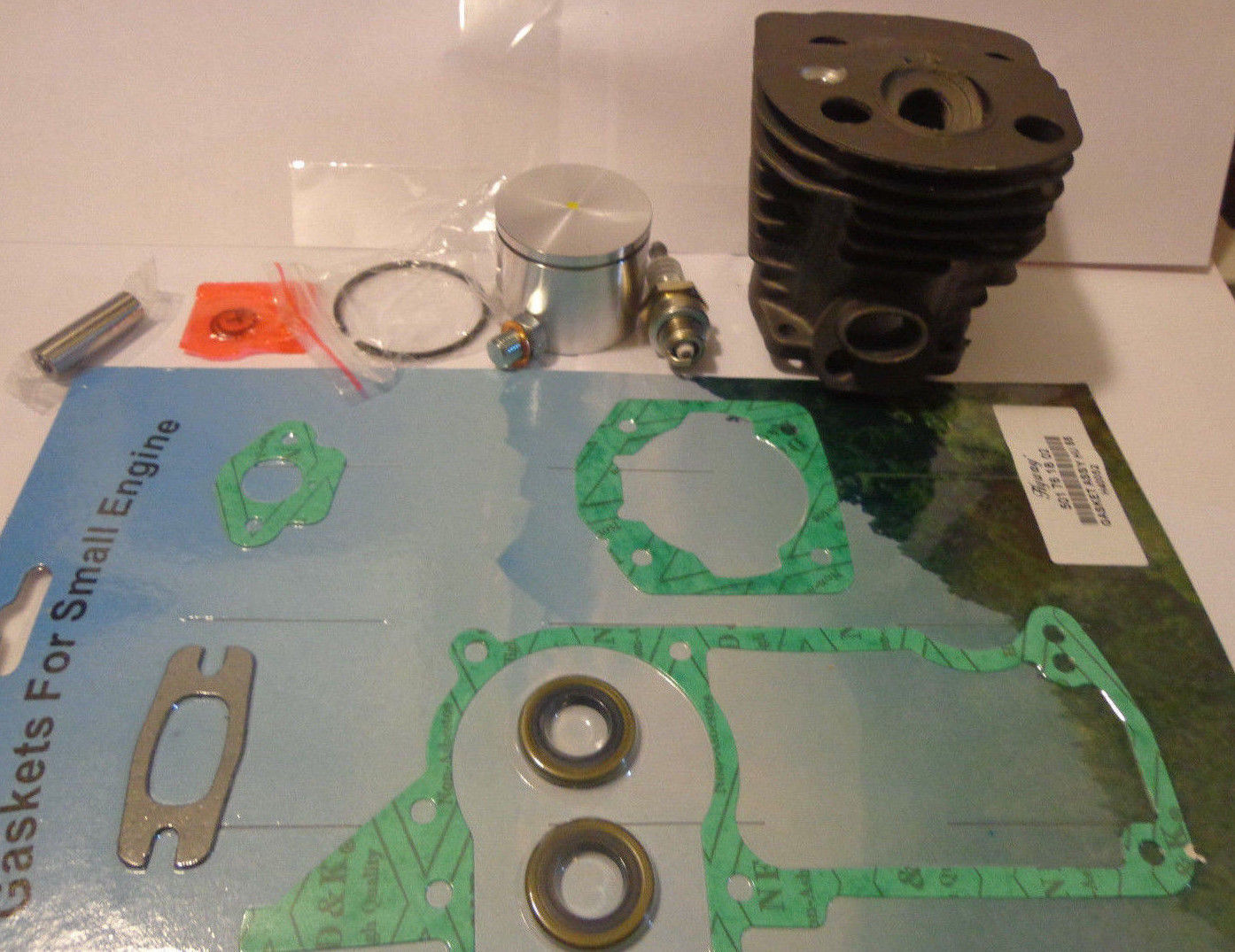 Husqvarna 55, 55 Rancher cylinder kit ,spark plug, oil seals ,overhaul kit 46mm