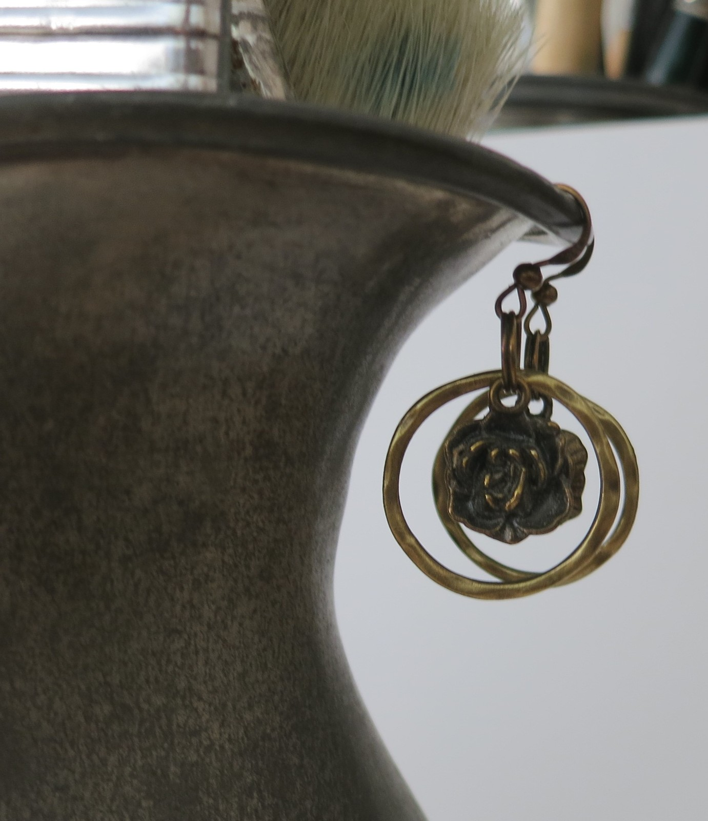 Simple bronze finish dangle earrings, hammered circle and a rose