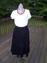 Vintage Black Flared Bottom Skirt  Label reads Feelin Jazzie - $9.99