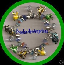 Bracelet Enamel 8 Fish Charms Stretchie Silvertone VGC - $19.75