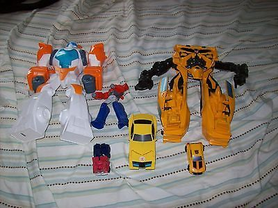 LOT OF 6 MATTEL TRANSFORMERS ACTION FIGURES AND CARS