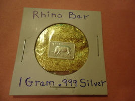 "ONE GRAM (.999) SILVER-RHINO  & BAG OF FLAKES WITH ""MINUTE"" 24K GOLD PAR... - $2.50"
