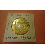 """ONE GRAM (.999) SILVER-RHINO  & BAG OF FLAKES WITH """"MINUTE"""" 24K GOLD PAR... - $2.50"""