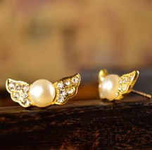 Pearl Wing Studs - $5.80
