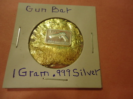 "ONE GRAM (.999) SILVER-GUN  & BAG OF FLAKES WITH ""MINUTE"" 24K GOLD PARTIC - $2.50"