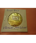 """ONE GRAM (.999) SILVER-GUN  & BAG OF FLAKES WITH """"MINUTE"""" 24K GOLD PARTIC - $2.50"""