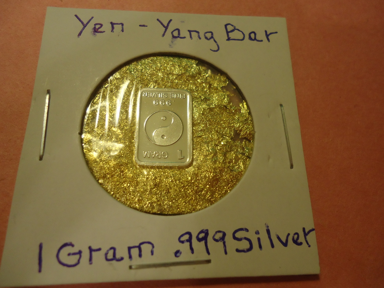 "Primary image for ONE GRAM (.999) SILVER-YIN YANG  & BAG OF FLAKES WITH ""MINUTE"" 24K GOLD PARTICL"