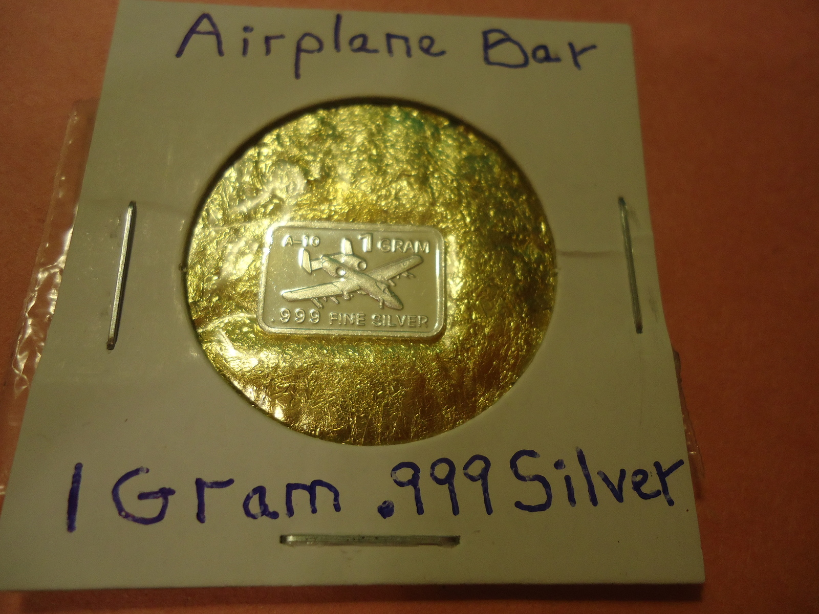 "Primary image for ONE GRAM (.999) SILVER-AIRPLANE  & BAG OF FLAKES WITH ""MINUTE"" 24K GOLD PARTICL"