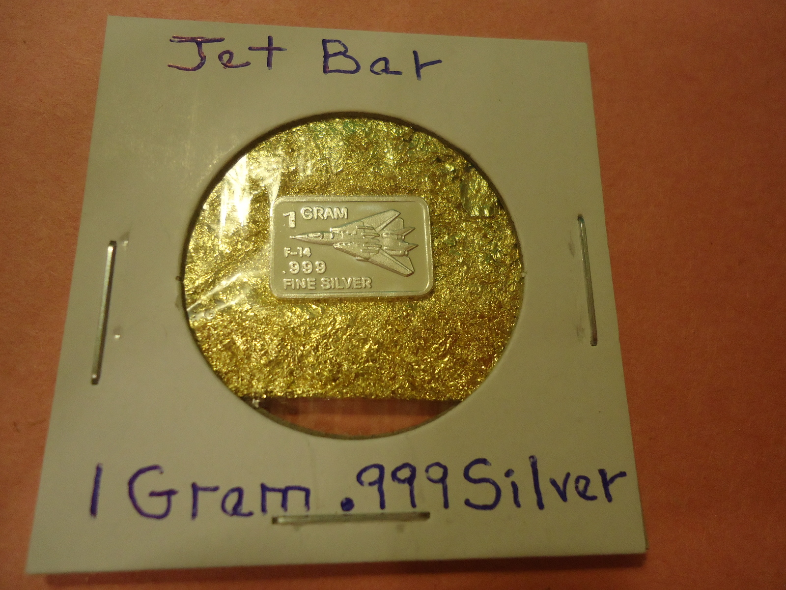 "Primary image for ONE GRAM (.999) SILVER-JET  & BAG OF FLAKES WITH ""MINUTE"" 24K GOLD PARTICL"