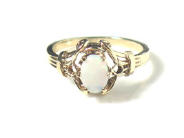 10k Yellow Gold Opal Ring With An Antique Looking Figary Design - $95.00