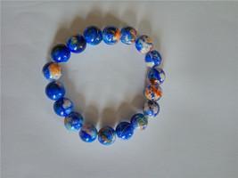 MULTI - COLORED  ELASTIC GLASS BEAD BRACELET  - $6.50