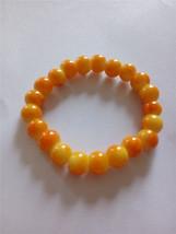 Yellow And Orange Colored Elastic Glass Bead Bracelet  - $6.50