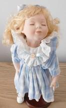 "Cute 15"" Geppeddo Sleeping Porcelain Doll - $45.00"