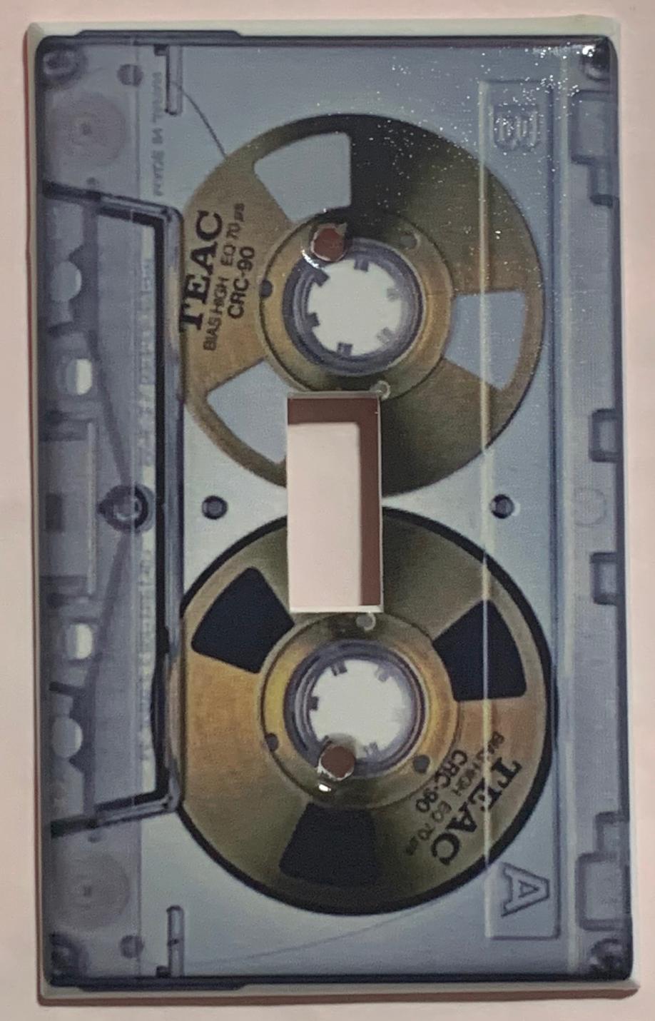 Cassette tape single toggle