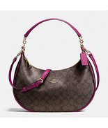 Coach East/West Harley Hobo in Signature Print ... - $210.00
