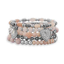Set of 5 Silver Tone Multicharm Fashion Stretch Bracelets with Pink Beads - $39.00