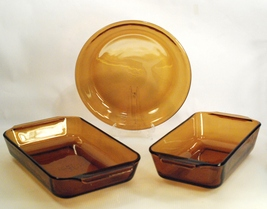 "Fire King Amber Glass (3) Bake Pans 1.5 Qt Casserole - 1 Qt Loaf - 9"" Ro... - $24.00"