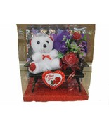 GIFT WITH FLOWERS  AND A SMALL TEDDY BEAR SITTING ON A CHAIR - $14.01