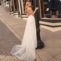 Backless Appliqued with Lace Deep V Neck Beach Wedding Gown Spaghetti Strap image 2