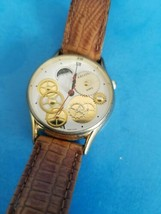 VINTAGE KINETIC WRIST WATCH MADE IN HONG KONG.SMALL BAND.SOLD AS IS.UNTE... - $32.71
