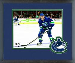 Christopher Tanev 2016-17 Canucks Action - 11x14 Logo Matted/Framed Photo - $42.95