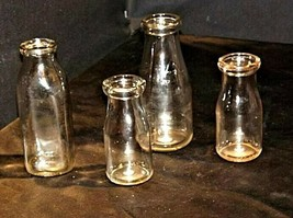 4 Antique Glass Milk Bottles  AB 309