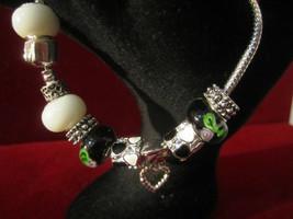Fun Charm Bracelet Black & White & Silvertone Theme - $13.00