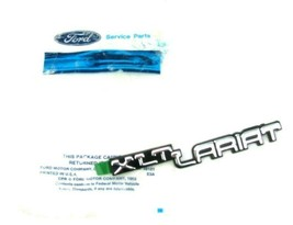Ford Xlt Lariat Emblem Name Plate Nos E7TZ-1504460-C Original Oem Part F150 Dash - $29.39