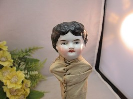 Porcelain doll head on a stick. Black hair. Blue eyes - $17.09