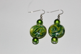 Green swirl glass dangle earrings - $9.50