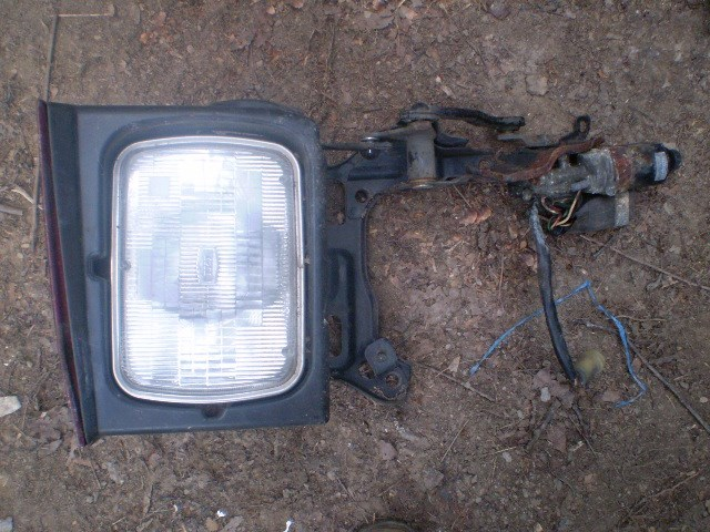 Primary image for 1987.5 Subaru XT6 (wonder wedge)Hideaway headlight assembly R or L side